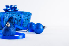 Christmas gift with blue balls Royalty Free Stock Image