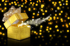 Christmas gift, bokeh background. Christmas gift,  golden bokeh background Royalty Free Stock Image