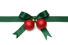 Christmas Gift Bow. Red christmas baubles with green ribbon, isolated on white Stock Photos