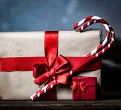 Christmas gift with bowknot and cup of tea. On grey background stock images