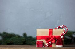 Christmas gift with bowknot and lollipop. On grey background royalty free stock photo