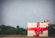 Christmas gift with bowknot and lollipop. On grey background royalty free stock photos