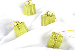 Christmas gift box. Four golden Christmas gift box Stock Photo