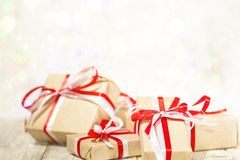 Christmas gift box against bokeh background. Holiday greeting card decorated with snow stock photo