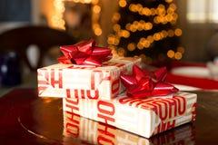 Christmas gift box against bokeh light Royalty Free Stock Photos