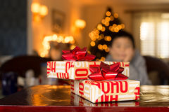 Christmas gift box against bokeh light Royalty Free Stock Images