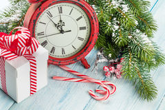 Christmas gift box, alarm clock, candy cane and fir tree Stock Photography