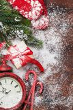 Christmas gift box and alarm clock stock images