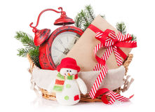 Christmas gift box, alarm clock and snowman toy Royalty Free Stock Photo