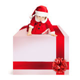 Christmas Gift Box and Baby in Santa Hat Royalty Free Stock Photography