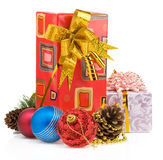 Christmas gift box with balls on white Royalty Free Stock Photos