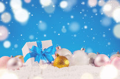Christmas gift box and balls Royalty Free Stock Photos