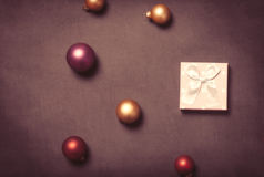 Christmas gift box and baubles Royalty Free Stock Photo