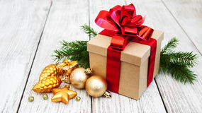 Christmas gift box and baubles Stock Photography