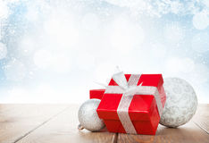 Christmas gift box and baubles Stock Image