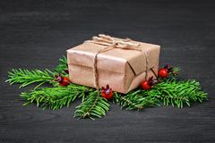 Christmas gift box on black wooden table Stock Photo