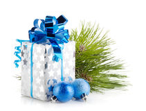 Christmas gift box and blue baubles Royalty Free Stock Photo