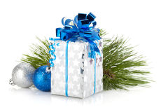 Christmas gift box and blue baubles Royalty Free Stock Photography