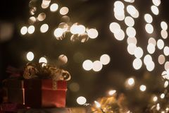 Christmas gift box with bokeh lights background.  Stock Image
