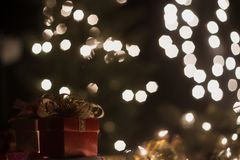 Christmas gift box with bokeh lights background.  Royalty Free Stock Image