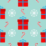 Christmas gift box with bow, snowflake red and white candy cane. Seamless Pattern Decoration. Wrapping paper, textile template. Bl. Ue background. Flat design Stock Photography