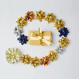 Christmas gift box with bows and stars on white background. Royalty Free Stock Images