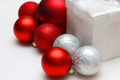 Christmas Gift Box and Bulb Ornaments Royalty Free Stock Photo