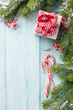 Christmas gift box, candy cane and fir tree Royalty Free Stock Photography