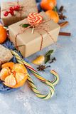 Christmas gift box, candy cane, tangerines stock photo
