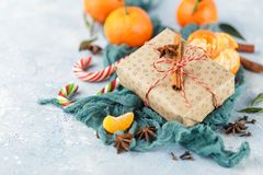 Christmas gift box, candy cane, tangerines stock photography