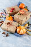 Christmas gift box, candy cane, tangerines stock images
