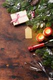Christmas gift box and champagne bottle Stock Photos