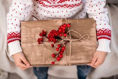 Christmas gift box in child`s hands. Close-up. royalty free stock image