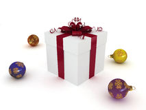 Christmas gift box and christmas balls Royalty Free Stock Image