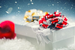 Christmas gift box with christmas balls in abstract snowy scene Royalty Free Stock Photography