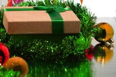 Christmas gift box with christmas balls royalty free stock photo