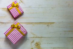 Christmas gift box. Christmas present in box at white wooden tab royalty free stock photography