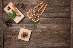Christmas gift box, cinnamon sticks, anise, orange slices, fir t Royalty Free Stock Images