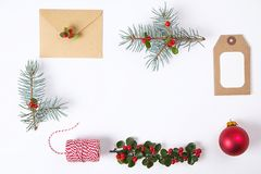 Christmas gift box collection with envelope, ribbon, red berries for mock up template design. View from above. Flat lay, copy spac royalty free stock photo