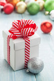 Christmas gift box and colorful baubles Stock Photography