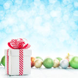 Christmas gift box and colorful baubles Stock Photo