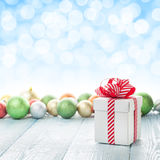 Christmas gift box and colorful baubles decor Stock Images