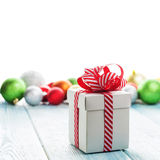 Christmas gift box and colorful baubles decor Stock Photos