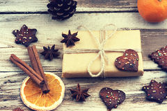 Christmas gift box, cookies and fruits Stock Photos
