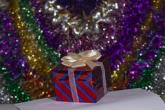 Christmas gift box with a cream bow. Royalty Free Stock Photography