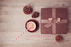Christmas gift box with cup of chocolate on wooden table. View from above Royalty Free Stock Image