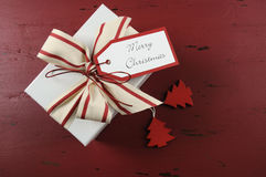 Christmas gift box on dark red recycled wood Royalty Free Stock Photos