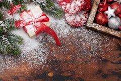 Christmas gift box, decor and fir tree stock photos