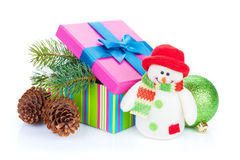 Christmas gift box, decor and snowman toy Royalty Free Stock Photos
