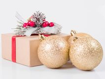 Christmas gift boxes and Christmas balls on a white background stock image